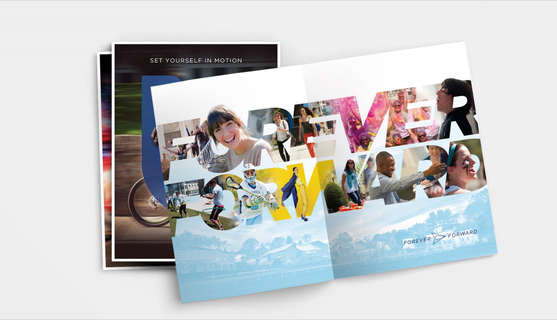 Open spread of view books with new Lasell University branding and Forever Forward message.